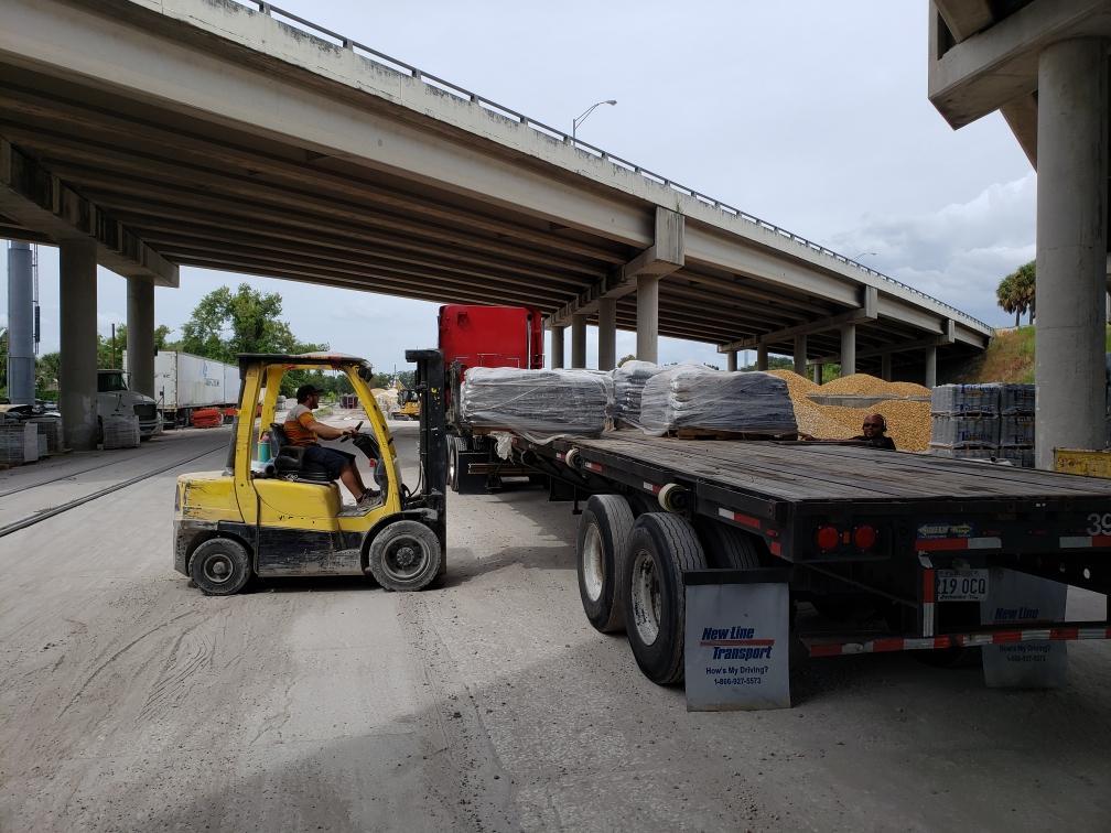 buy sand bags loading truck