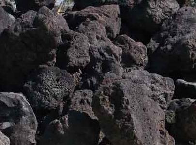 black lava rock boulders