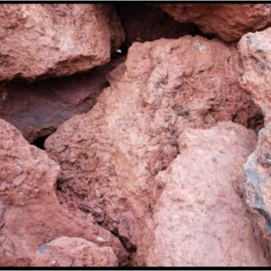 pile of red lave rock boulders
